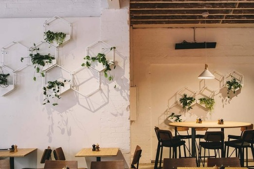 The lush and minimal interiors of Rustica Canteen.