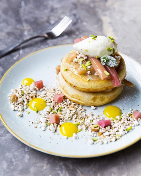 Pancakes with poached rhubarb, puffed grains, toasted hazelnuts and creme fraiche at St Ali in South Melbourne.