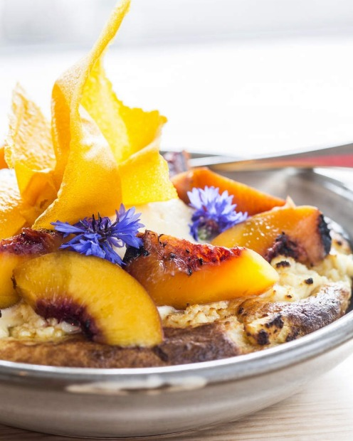 Ricotta hot cake with maple syrup, grilled peaches and cream at Barry in Northcote.