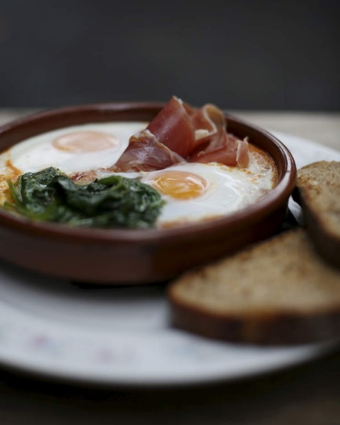 Soft baked eggs with jamon, ramchero and rye from Reuben Hills in Surry Hills.