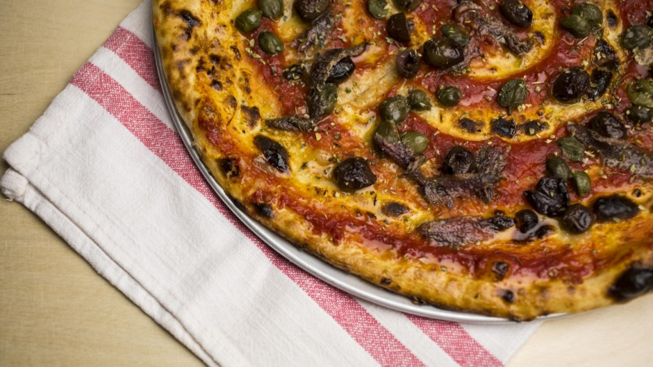 The pizza marinara is the go-to dish at the Dolphin Hotel.