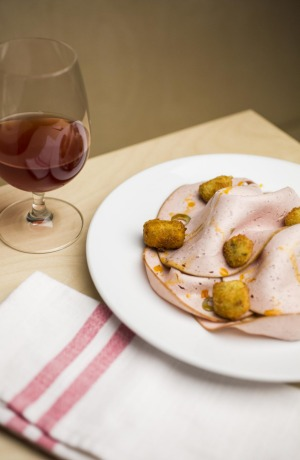 From the salumni cabinet: LP's Quality Meats mortadella and olive fritti.