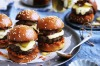 Beef sliders with bacon, gruyere and pickles with tomato jam.