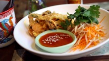 Hoy Tod, crispy mussel omelette with bean shoots and house-made sriracha sauce, at Middle Fish in Carlton.