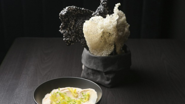 Tarama with celery leaves and crackers.