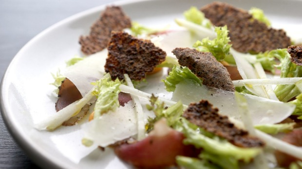 Duck prosciutto with mustard crackers, pears and leaves.