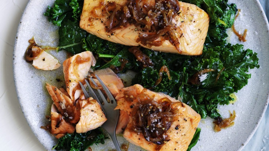 Quick, healthy dinner: Salmon fillets with caramelised onion and wilted greens.