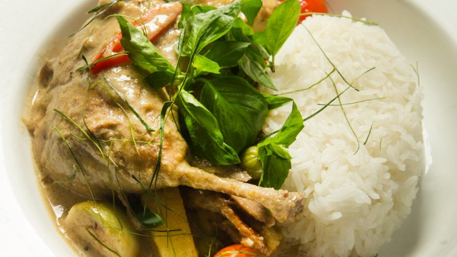 Slow-braised green curry duck leg.