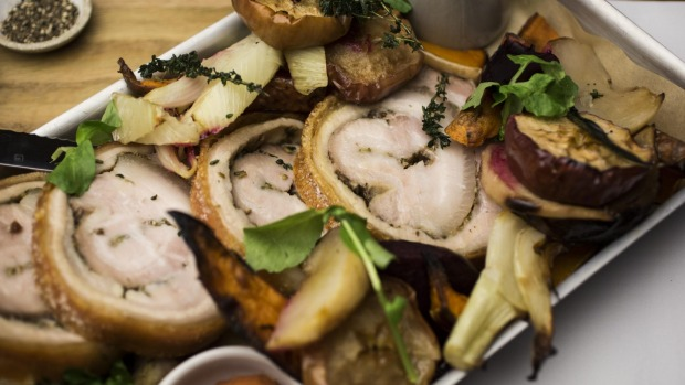 Go-to dish: Slow-roasted porchetta with vegetables, spiced half apple and quince sauce.