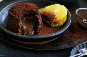 Neil Perry's chocolate fondant cake with Grand Marnier poached oranges.