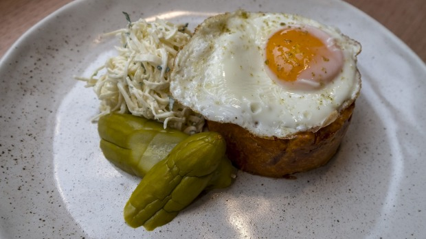 Quiche lorraine topped with a fried egg.