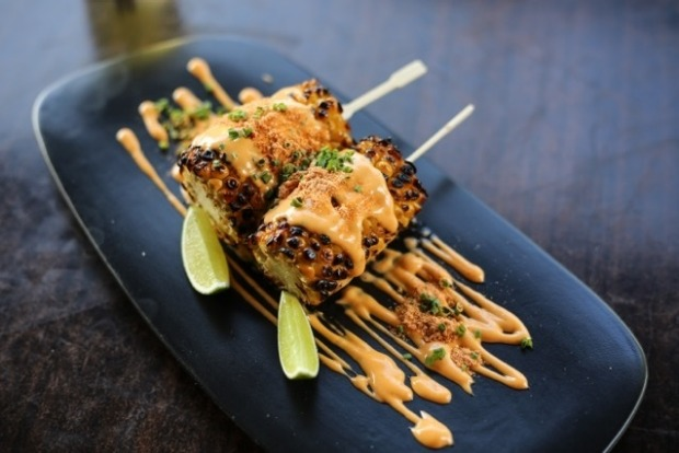 Char-grilled corn with chipotle mayo and toasted masa at The Black Toro.