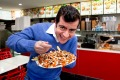 Sam Dastyari downs a meaty halal snack pack.