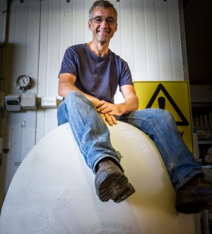 Bryan Martin sitting on an egg