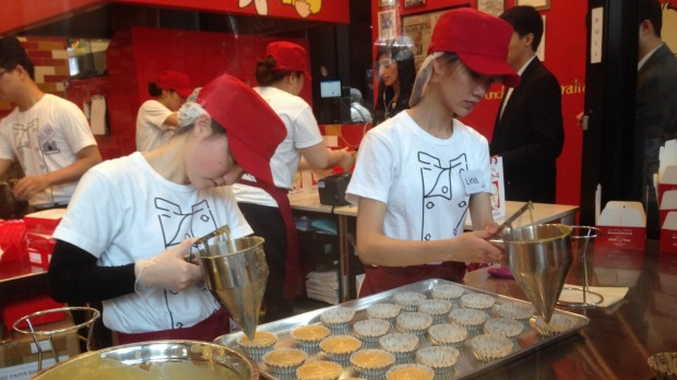 Employees working on pastries at Uncle Tetsu's Japanese Cheesecake store at Regent Place.
