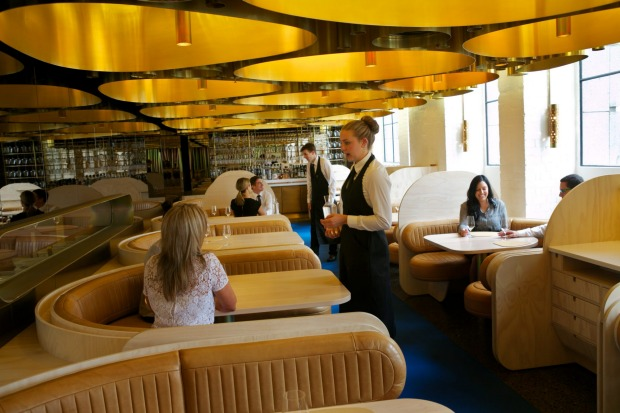 The Press Club features plush horseshoe-shaped booths.