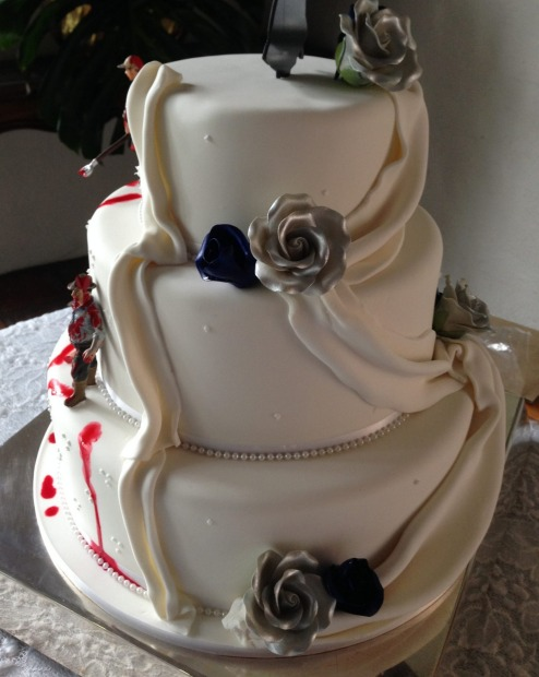The zombie wedding cake looked more traditional on one side, and more bloody and gruesome on the other.