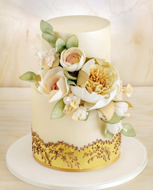 A white wedding cake doesn't have to look old-fashioned as this Faye Cahill Cake Design two-tier cake proves.