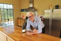 Winemaker Philip Shaw in his kitchen - where the joinery is made from old oak vats.