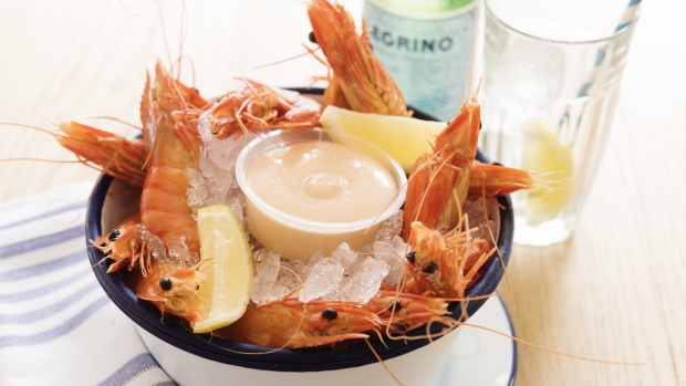 A bucket of prawns helps maintain the summery, holiday feel.