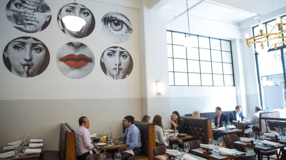 Fornasetti wallpaper makes a striking feature at Massi in Melbourne.