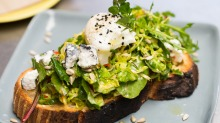 Savoury toast with raw shaved brussels sprout, lemon zest, chilli, toasted at Two Chaps.