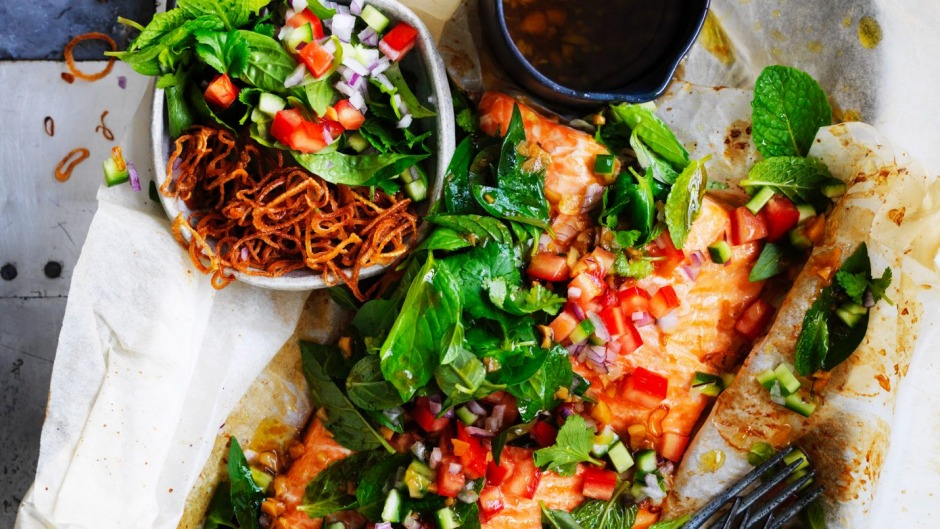 Paper-baked salmon with salsa of Asian herbs.