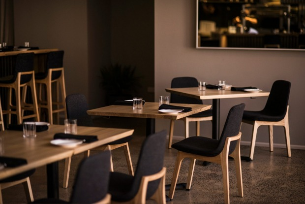 The soothing grey dining room at Igni in Geelong's backstreets.
