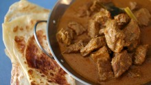 Beef rendang served with roti at Island Dreams Cafe.