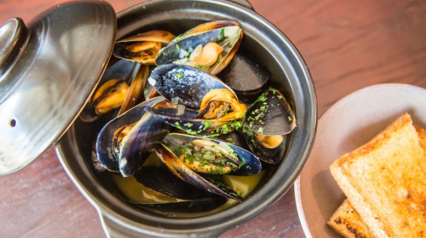 Mussels in white wine demand hot-buttered bread and a glass of something cold.