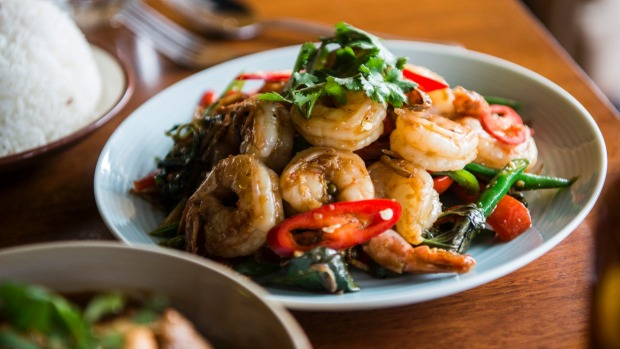 Go-to dish: Char-fried prawns with mixed fresh herbs.