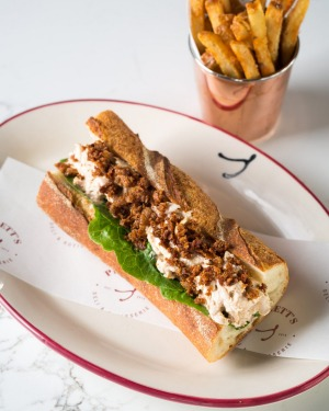 Rotisserie chicken baguette and chips.