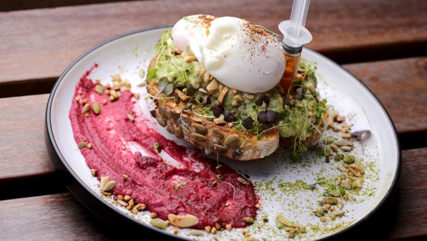 'Properly bashed' avocado with beetroot hummus and poached eggs.