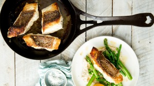 A delicious crispy skinned snapper recipe served with macadamia cream and asparagus.