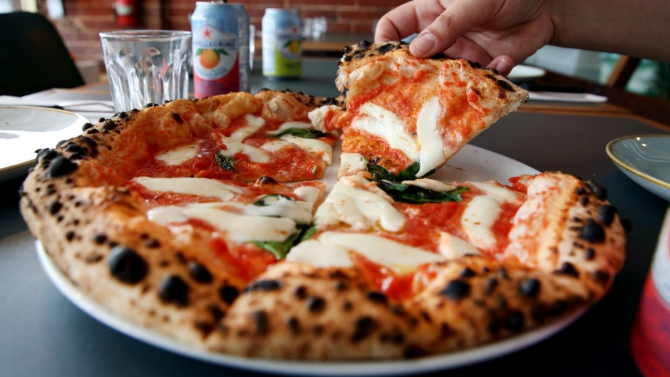 Puffy-crusted margherita pizza.