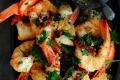Garlic-lovers: Neil Perry's pan-fried prawns with roast garlic and chipotle oil.