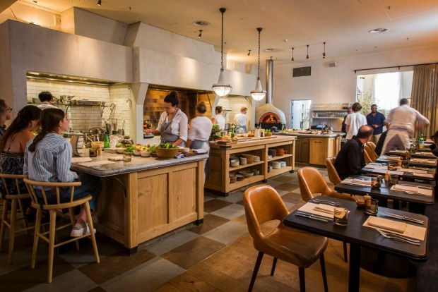 Fred's, Merivale's new Californian-style restaurant in Sydney, features a central hearth and open kitchen.