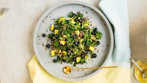 Kale, quinoa and blueberry salad with coconut dressing.