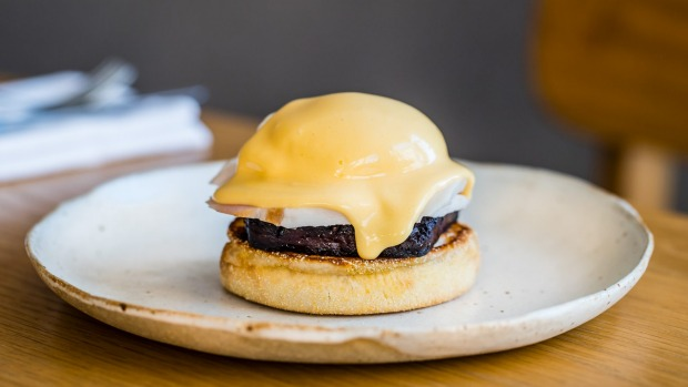 Clayton Wells serves his version of eggs benny with black pudding.
