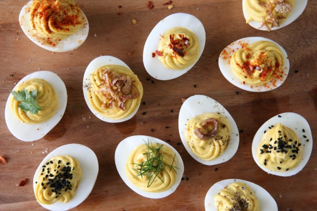 Retro favourite: Devilled eggs, topped with caviar, of course <a ...