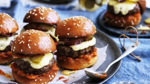 Beef sliders with bacon, cheese and pickles.