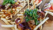 Peking duck loaded fries from Bao Stop at the Night Noodle Markets.