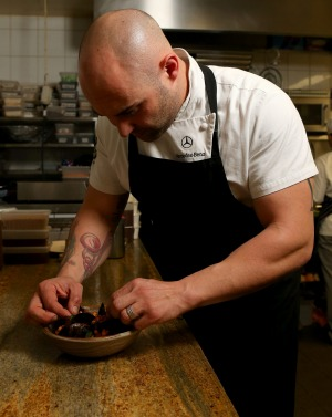 Shane plates up the dish at Melbourne's Maha.