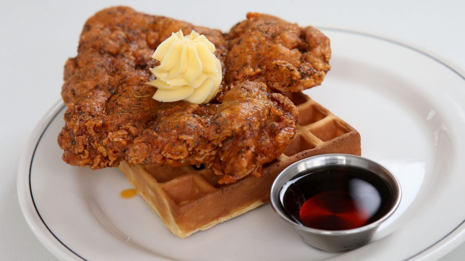 Fried chicken and waffle with whipped butter and bourbon-spiked maple syrup.