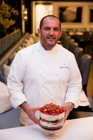 Chef Guillaume Brahimi with his signature dessert at Bistro Guillaume in Sydney.