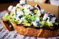 Beyond Vegemite: Toast topped with avocado, charcoal-dusted goat's cheese, chili flakes and sesame seeds.