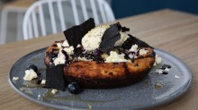 Buttermilk hotcake with shards of blueberry 'leather'.