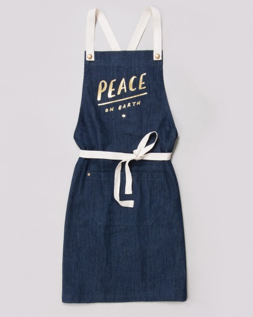 This Peace on Earth apron from Cargo Crew is perfect for Christmas baking projects, $39.50, <a ...