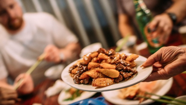 """Eating stir-fried beef and potatoes in Sham Sui Po. """"The whole lot gets deep fried before it gets coated in the ..."""