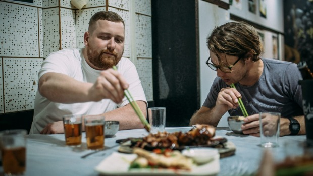 Patrick Friesen (left) and Christopher Hogarth at Tai Chung Wang, which is famous for its black pepper pork knuckle. The ...